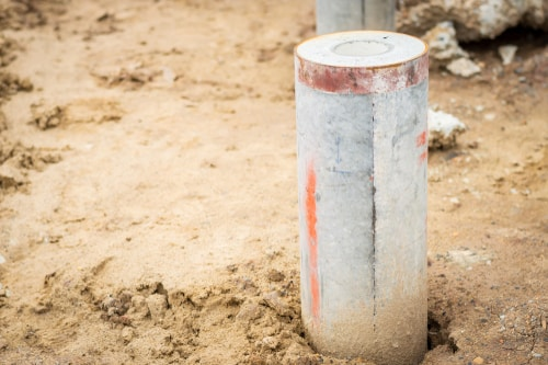 Round,Spun,Micropile,On,Construction,Site.,Concrete,Pile,For,Foundation